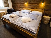 Pokoje hotelu Kristian jsou pro vás připraveny.