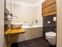 Stylová koupelna horského hotelu Kristian 1000