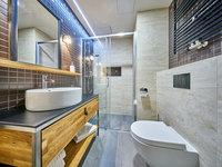 Krásná designová koupelna přímo na pokoji.